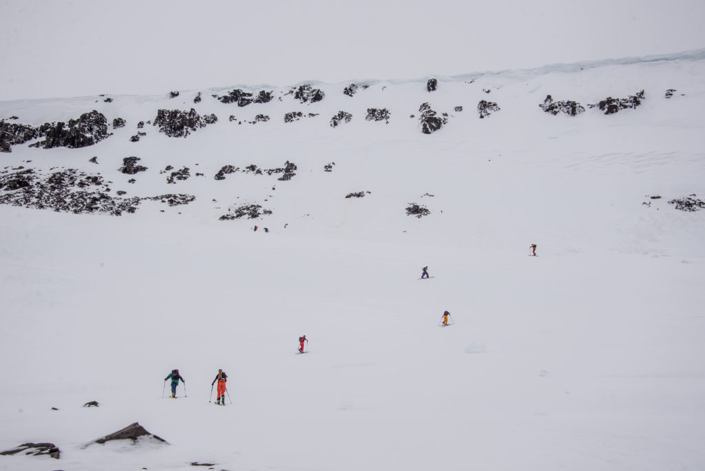 Several people crossing a snowy landscape on skis